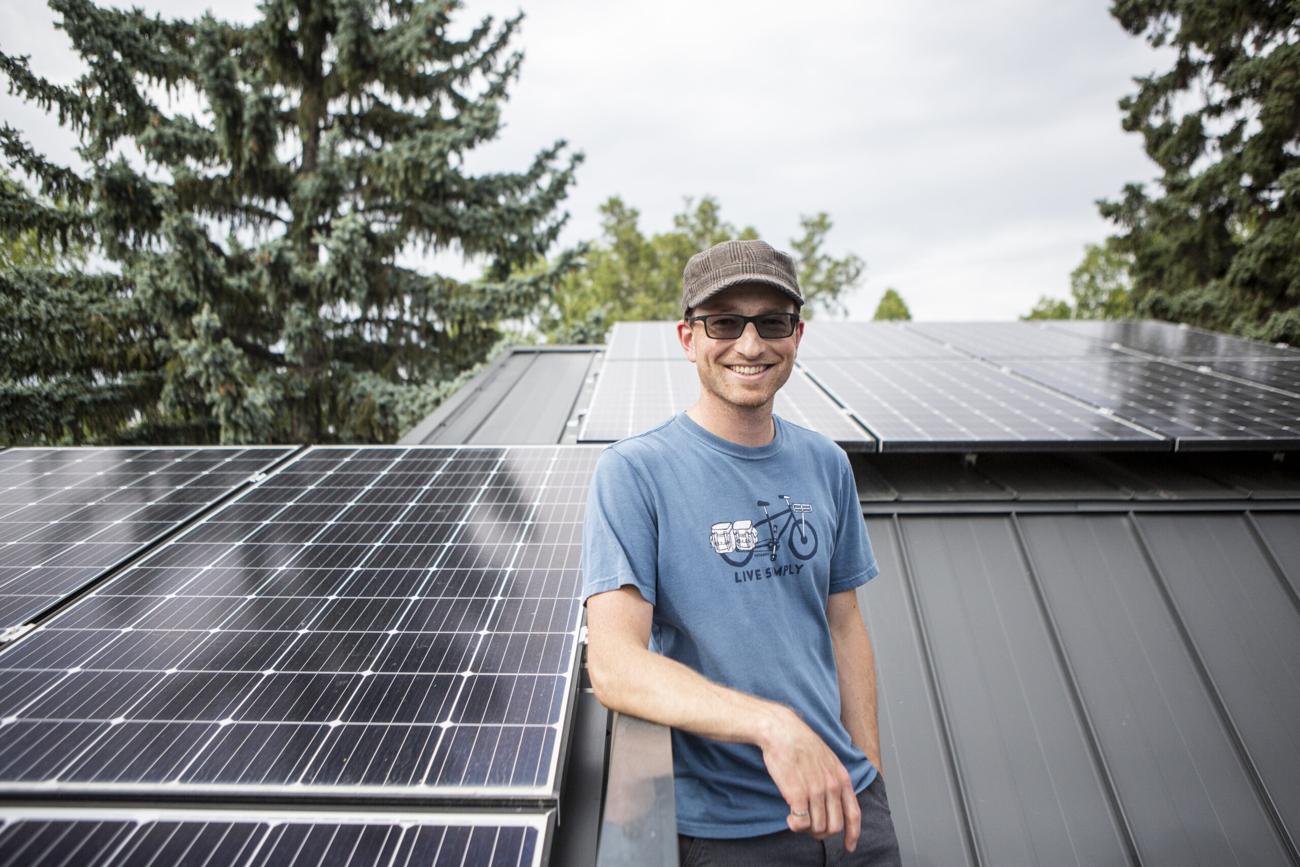 Homeowner on roof with solar panels